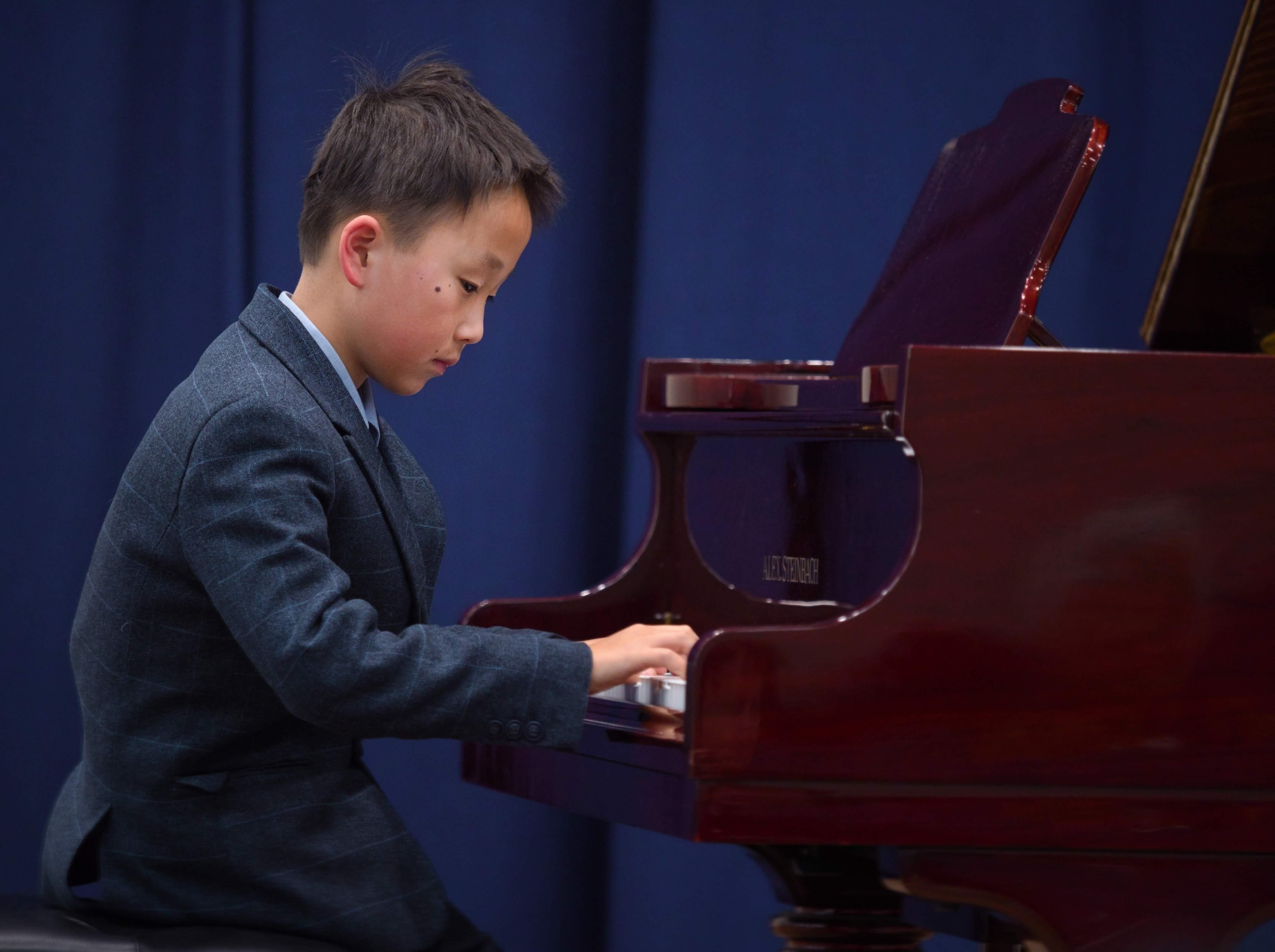 WGE Pianoforte Day 1 Harry Zhou Displays his skills on the Piano